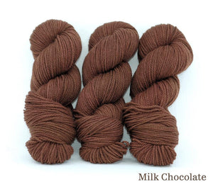 Three skeins of Ancient Arts Lascaux Worsted in Milk Chocolate