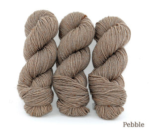 Three skeins of Ancient Arts Lascaux Worsted in Pebble