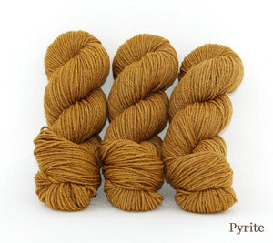 Three skeins of Ancient Arts Lascaux Worsted in Pyrite