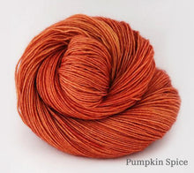 Load image into Gallery viewer, A ball of Ancient Arts Socknado in Pumpkin Spice
