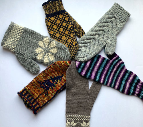 An assortment of hand-knit mittens