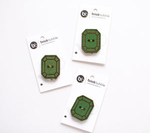 Three Brickbubble wooden buttons in an emerald shape