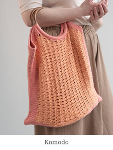A model holding Komodo bag