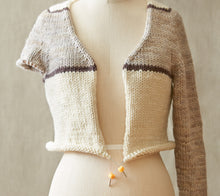 Load image into Gallery viewer, A mannequin wearing a partially knit sweater on a stitch holder that has Cocoknits Stitch Stoppers on the ends