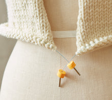 Load image into Gallery viewer, Cocoknits Stitch Stoppers on the ends of a stitch holder