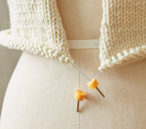 Cocoknits Stitch Stoppers on the ends of a stitch holder