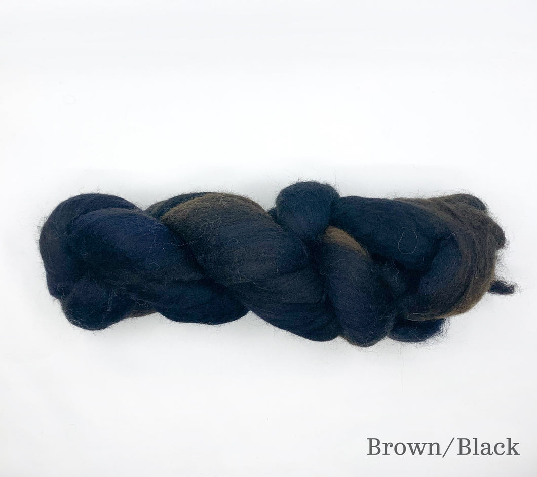 A skein of Fleece Artist Merino Sliver in Brown/Black