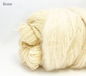 A close up of Fleece Artist Queen's County Kits in Bone