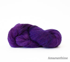 A skein of Hand Maiden Superkid Silk in Amaranthine