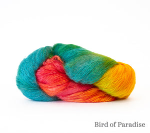 A skein of Hand Maiden Superkid Silk in Bird of Paradise