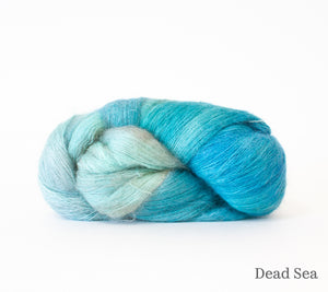 A skein of Hand Maiden Superkid Silk in Dead Sea