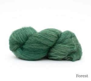 A skein of Hand Maiden Superkid Silk in Forest