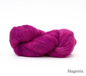A skein of Hand Maiden Superkid Silk in Magenta