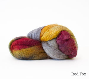A skein of Hand Maiden Superkid Silk in  Red Fox