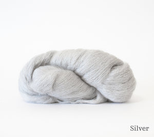 A skein of Hand Maiden Superkid Silk in Silver