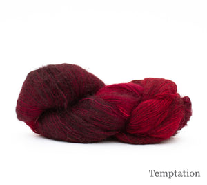 A skein of Hand Maiden Superkid Silk in Temptation
