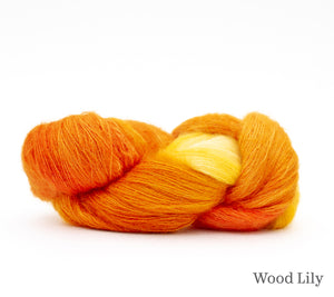 A skein of Hand Maiden Superkid Silk in Wood Lily