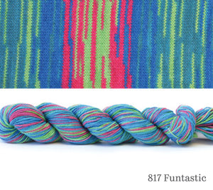 A skein and a knitted swatch of Hikoo CoBaSi Multi in 817 Funtastic