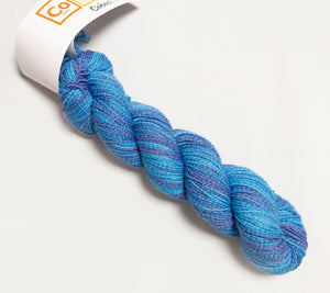 A skein of Hikoo CoBaSi Multi in 816 Bluestreak