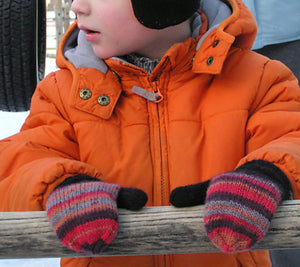 Child wearing Tobie's Mittens in red and black