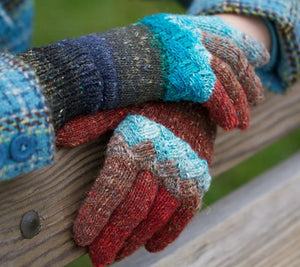 Hands wearing Woven Knuckles gloves in red and blue