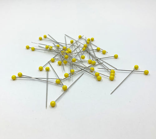 Holli Yeoh Super Sharp Straight Pins with yellow heads in a pile