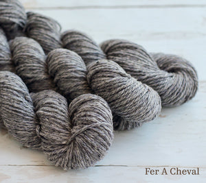 Three skeins of Julie Asselin Nurtured in Fer A Cheval