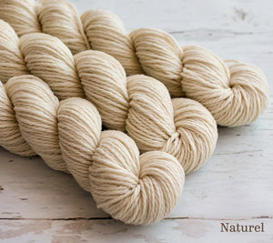 Three skeins of Julie Asselin Nurtured in Naturel