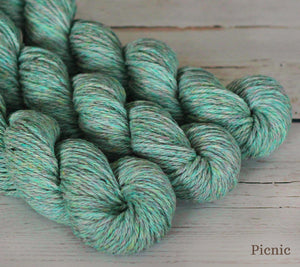 Three skeins of Julie Asselin Nurtured in Picnic