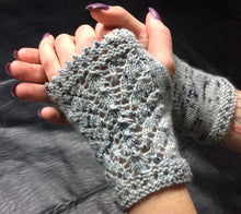 Load image into Gallery viewer, A pair of hands wearing Snow Queen Wristlets in grey