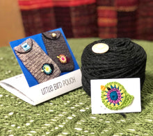 Load image into Gallery viewer, Crocheted pouch with a little bird with black yarn