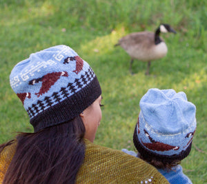 A mom and a daughter wearing Little Goose Tuques