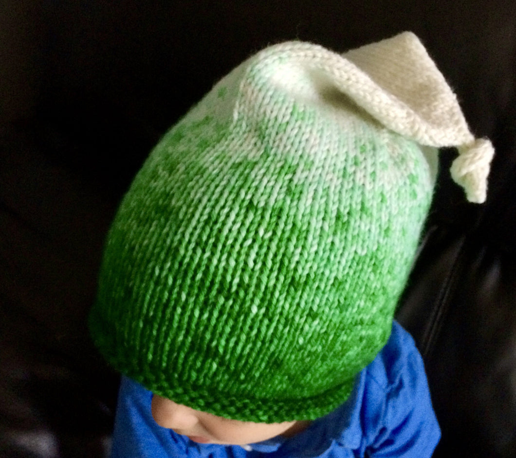 A green and white Epic Elf Beanie