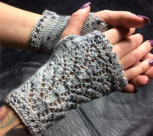 A pair of hands wearing Snow Queen Wristlets in grey