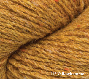 A close up of Rowan Valley Tweed in 112 Yellowhammer