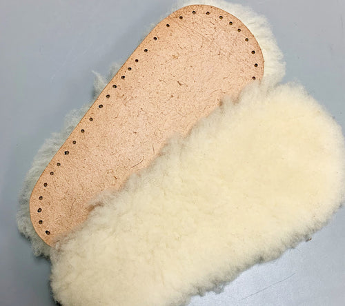 A pair of Sheepskin Soles in adult size