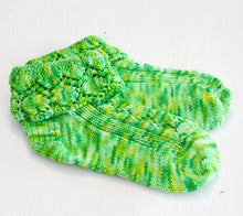 Load image into Gallery viewer, A Pair of Dorothy Socks by Valerie Johnson knit out of Flash Mob Pages The Wizard of Oz