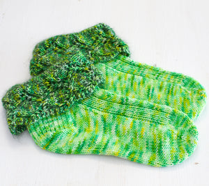 A Pair of Dorothy Socks by Valerie Johnson knit out of Flash Mob Pages The Wizard of Oz with mohair included in the cuffs