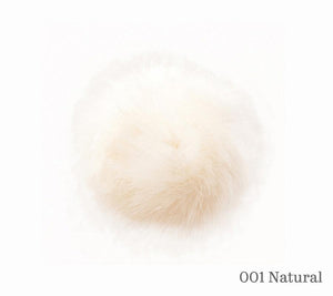 A 13 centimetre Wild Wild Wool Pom-Pom in the colour 001 Natural