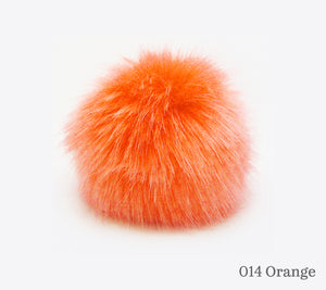 A 10 centimetre Wild Wild Wool Faux Fur Pom-Pom in 014 Orange