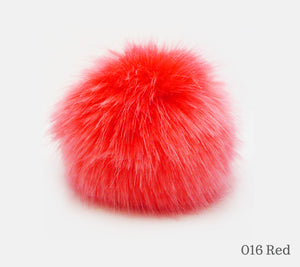 A 10 centimetre Wild Wild Wool Faux Fur Pom-Pom in 016 Red