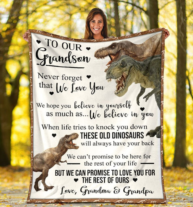 To Our Grandson Never Forget That We Love You We Hope You Believe In Your Self Dinosaur Fleece Blanket - ATMTEE