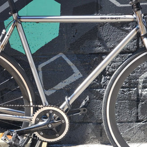 Big Shot Bikes - Fixed Gear Bike with industrial frame and matte black rims.
