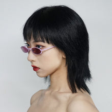 Load image into Gallery viewer, berry colour oval sunglasses in pink stainless steel frame with a tiny bug on the bottom of the right lens on model 45 angled