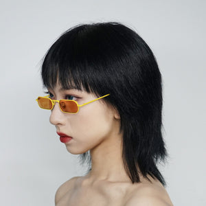 stadium shaped sunglasses with dark yellow lens and yellow stainless steel frame on model 45 angled