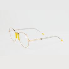 Load image into Gallery viewer, gold colour titanium round optical frame with yellow acetate nose pads and temple tips 45 angled