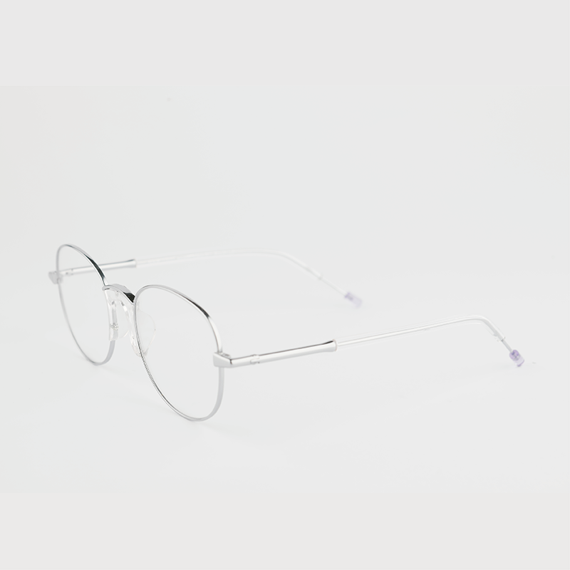 silver colour titanium round optical frame with clear acetate temples 45 angled