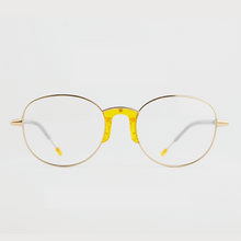 Load image into Gallery viewer, gold colour titanium round optical frame with yellow acetate nose pads and temple tips front