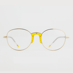 gold colour titanium round optical frame with yellow acetate nose pads and temple tips front