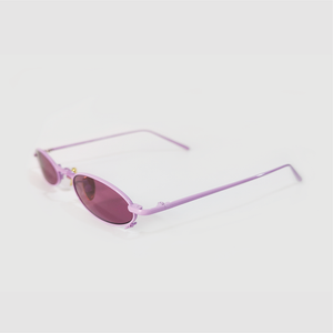 berry colour oval sunglasses in pink stainless steel frame with a tiny bug on the bottom of the right lens side shot